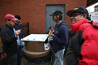(180112RREI4426)  La Esquina Documentary Project. Latinos have gathered near the 7 - 11 at the corner of Mt. Pleasant St. and Kenyon St. NW. for more than 40 years.  Mt. Pleasant, Washngton DC Jan. 12, 2018 . ©  Rick Reinhard  2018     email   rick@rickreinhard.com