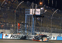Apr 19, 2007; Avondale, AZ, USA; Nascar Grand National Division driver (10) Joey Logano takes the checkered flag to win the AlphaTrade.com 150 at Phoenix International Raceway. Mandatory Credit: Mark J. Rebilas