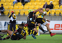 Ben Lam slips the tackle of Charlie Ngatai during the Super Rugby match between the Hurricanes and Chiefs at Westpac Stadium in Wellington, New Zealand on Friday, 13 April 2018. Photo: Dave Lintott / lintottphoto.co.nz