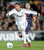 FC Barcelona's Xavi Hernandez (r) and Real Madrid's Cristiano Ronaldo during Copa del Rey - King's Cup semifinal second match.February 26,2013. (ALTERPHOTOS/Acero) /Nortephoto