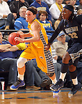 BROOKINGS, SD - NOVEMBER 15:  Megan Waytashek #24 from South Dakota State University drives past Shayla Cooper #32 from Georgetown in the second half of their game Friday night at Frost Arena. (Photo by Dave Eggen/Inertia)
