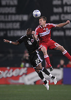 Chicago Fire forward Brian McBride (20) heads the ball over DC United midfielder Rodney Wallace (22) The Chicago Fire tied DC United 1-1 at RFK Stadium, Saturday March 28, 2009.