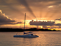 Sailboat off St. John, Virgin Islands and sunset.