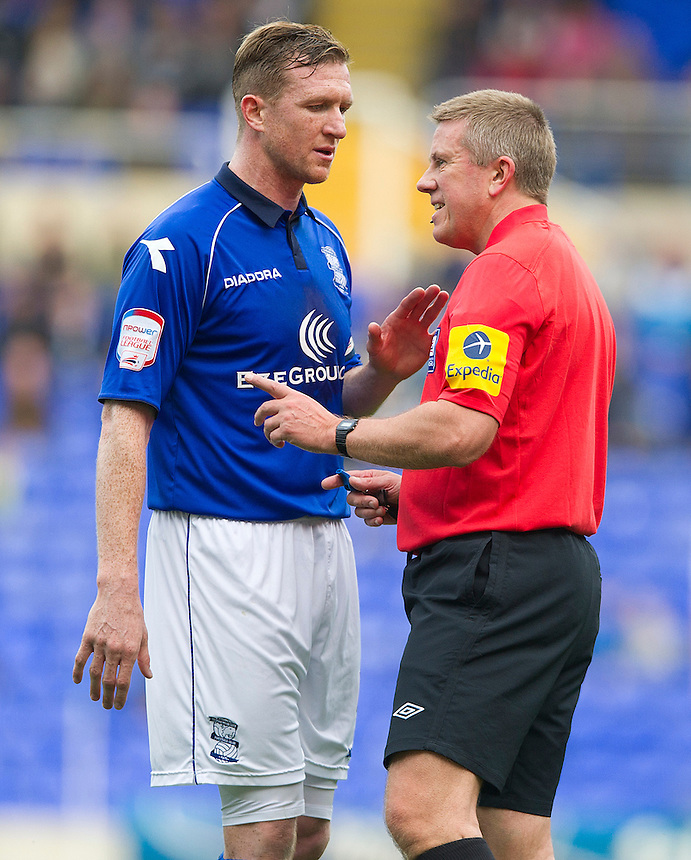 Referee Tony Bates speaks to Birmingham City's Stephen Caldwell ..Football - npower Football League Championship - Birmingham City v Leicester City - Saturday 20th October 2012 - St Andrews - Birmingham..