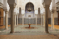Central courtyard of the Mausoleum of Moulay Ismail, or Moulay Ismail Ibn Sharif, reigned 1672ñ1727, second ruler of the Alaouite dynasty, built 1703 by Ahmed Eddahbi, Meknes, Meknes-Tafilalet, Morocco. The courtyard with its central fountain is surrounded by columns supporting decorative arches with carved stucco and zellige tiles in geometric patterns on the floor and walls. Meknes is a fortified Imperial city redeveloped under Sultan Moulay Ismail, 1634-1727, as Morocco's political capital. Picture by Manuel Cohen
