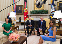 United States President Donald J. Trump meets with President Juan Carlos Varela of Panama in the Oval Office of the White House in Washington, DC on June 19, 2017.  Also seated are Lorena Castillo, left, and first lady Melanie Trump, right. <br /> Credit: Molly Riley / CNP /MediaPunch