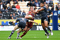 PICTURE BY ALEX WHITEHEAD/SWPIX.COM - Rugby League - Super League - Hull FC v Huddersfield Giants - KC Stadium, Hull, England - 01/07/12 - Huddersfield's Larne Patrick is tackled by Hull's Richard Horne and Willie Manu.