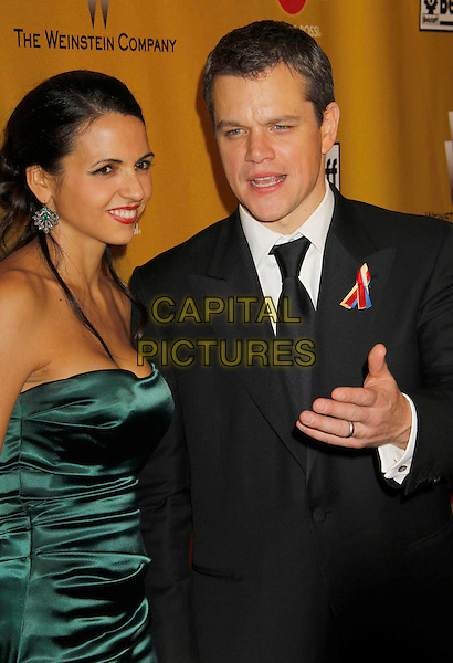 LUCIANA BARROSO & MATT DAMON.Weinstein Company Post Golden Globe Party held at Bar210 & Plush Ultra Lounge at the Beverly Hilton Hotel, Beverly Hills, California, USA..January 17th, 2009.globes half length green silk satin dress black suit jacket married husband wife hand mouth open.CAP/ADM/MJ.©Michael Jade/Admedia/Capital Pictures