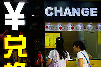 HONG KONG, MAY 08: A person exchanges money at a currency exchange booth showing the symbol of the Chinese yuan, on May 8, 2015, in Hong Kong. (Photo by Lucas Schifres/Pictobank)