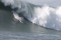 Carlos Burle competes in the 2010 Mavericks Surf Contest, Saturday, Feb. 13, 2010, Half Moon Bay, California.