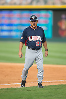 USCNT assistant coach Elliot Avent (26) coaches first base during the game against the Cuban National Team at BB&T BallPark on July 4, 2015 in Charlotte, North Carolina.  The United State Collegiate National Team defeated the Cuban National Team 11-1.  (Brian Westerholt/Four Seam Images)