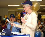 Jim Dooley and Charlotte Hall seen at the retirement Celebration for Tony Marro held at Melville Office of Newsday on Tuesday, August 12, 2003. (Photo / Jim Peppler).
