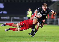 Bradley Davies of the Ospreys (R) is brought down by Aaron Shingler of the Scarlets during the Guinness PRO14 Round 6 match between Ospreys and Scarlets at The Liberty Stadium , Swansea, Wales, UK. Saturday 07 October 2017