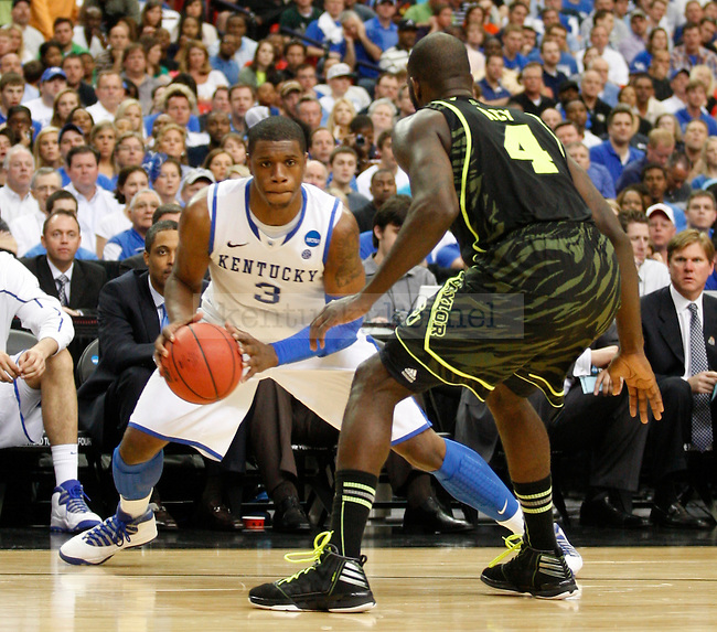 Quincy Acy guards Terrence Jones in the second half of the south region final between the University of Kentucky and Baylor University in the NCAA Tournament, in the Georgia Dome, on Sunday, March 25, 2012 in Atlanta, Ga. Kentucky defeated Baylor 82-70.  Photo by Latara Appleby | Staff. ..