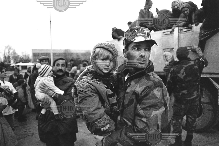 A convoy of Muslim refugees arrive in Tuzla from the east of the country, where the Serbs have launched an offensive.