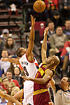 01/15/13--Portland Trail Blazers shooting guard C.J. McCollum (3) and Cleveland Cavaliers point guard Jarrett Jack (1) go up for a jump ball in the first half at Moda Center.<br />