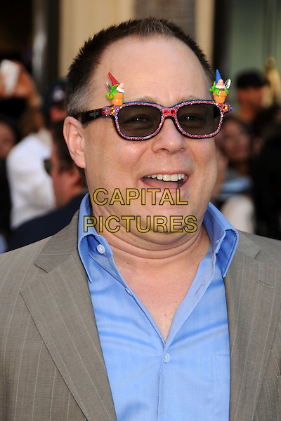 "KELLY ASBURY .Attending the ""Gnomeo and Juliet"" World Premiere held at the El Capitan Theatre, Hollywood, California, USA, .23rd January 2011..& arrivals portrait headshot blue shirt grey gray gnome glasses sunglasses novelty mouth open funny .CAP/ADM/BP.©Byron Purvis/AdMedia/Capital Pictures."