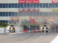 May 20, 2017; Topeka, KS, USA; NHRA top fuel driver Tony Schumacher (left) races alongside teammate Leah Pritchett in the quickest side by side race in NHRA history during qualifying for the Heartland Nationals at Heartland Park Topeka. Mandatory Credit: Mark J. Rebilas-USA TODAY Sports