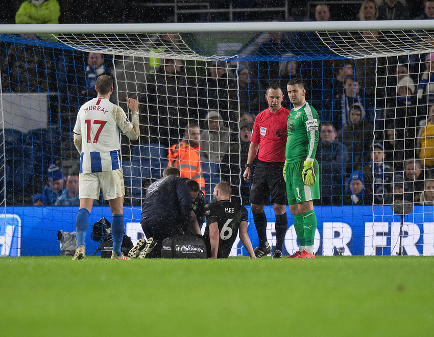 Burnley's Ben Mee receiving medical treatment after clashing with Brighton & Hove Albion's Glenn Murray <br /> <br /> Photographer David Horton/CameraSport<br /> <br /> The Premier League - Brighton and Hove Albion v Burnley - Saturday 9th February 2019 - The Amex Stadium - Brighton<br /> <br /> World Copyright © 2019 CameraSport. All rights reserved. 43 Linden Ave. Countesthorpe. Leicester. England. LE8 5PG - Tel: +44 (0) 116 277 4147 - admin@camerasport.com - www.camerasport.com