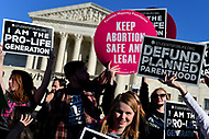 Washington, DC - January 19, 2018: People hold signs in front of the U.S. Supreme Court as tens of thousands  participate in the annual March for Life in Washington, D.C. January 19, 2018.  (Photo by Don Baxter/Media Images International)