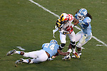 24 November 2012: Maryland's Nigel King (center) is tackled by UNC's Tre Boston (10) and Terry Shankle (24). The University of North Carolina Tar Heels played the University of Maryland Terrapins at Kenan Memorial Stadium in Chapel Hill, North Carolina in a 2012 NCAA Division I Football game. UNC won 45-38.