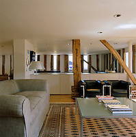 The original beams have been preserved and made into a feature of the open-plan living area