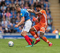 Portsmouth's Matthew Clarke (left) is tackled by Shrewsbury Town's Aaron Amadi-Holloway (right)  <br /> <br /> Photographer David Horton/CameraSport<br /> <br /> The EFL Sky Bet League One - Portsmouth v Shrewsbury Town - Saturday September 8th 2018 - Fratton Park - Portsmouth<br /> <br /> World Copyright &copy; 2018 CameraSport. All rights reserved. 43 Linden Ave. Countesthorpe. Leicester. England. LE8 5PG - Tel: +44 (0) 116 277 4147 - admin@camerasport.com - www.camerasport.com