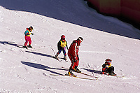 Young Children learning to Downhill Ski with Instructor, at Big White Ski Resort near Kelowna, in the Thompson Okanagan Region, British Columbia, Canada