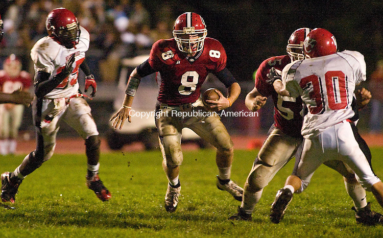 CHESHIRE, CT - 03 OCTOBER 2008 -100308JT05--<br /> Cheshire quarterback Billy Ragone, between Wilbur Cross' Gerald McClose (#85), right, #30 Juan Lugo, and teammate Tom Acampora (#54) during Friday's game at Cheshire.<br /> Josalee Thrift Republican-American