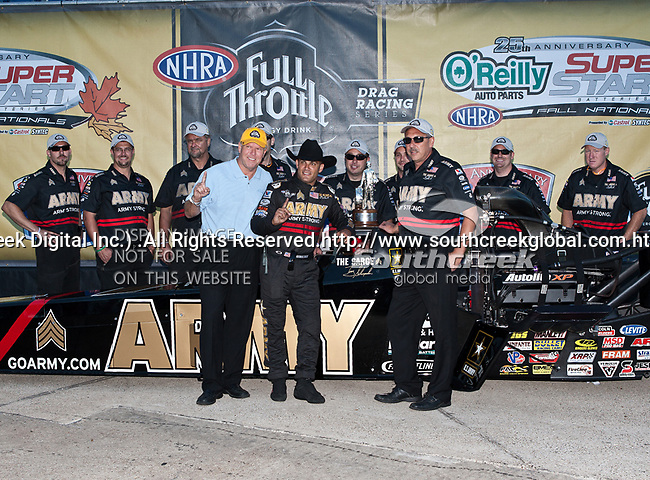 Tony Schumacher #1, driver for the Army's Top Fuel Dragster and crew in the Winners Circle with his Walley Trophy at the O'Reilly Fall Nationals held at the Texas Motorplex in  Ennis, Texas.