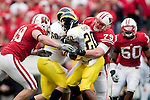 November 14, 2009: Wisconsin Badgers defensive linemen Jeff Stehle (79) and J.J. Watt (99) tackle Michigan Wolverines running back Michael Shaw (20) during an NCAA football game at Camp Randall Stadium on November 14, 2009 in Madison, Wisconsin. The Badgers won 45-24. (Photo by David Stluka)