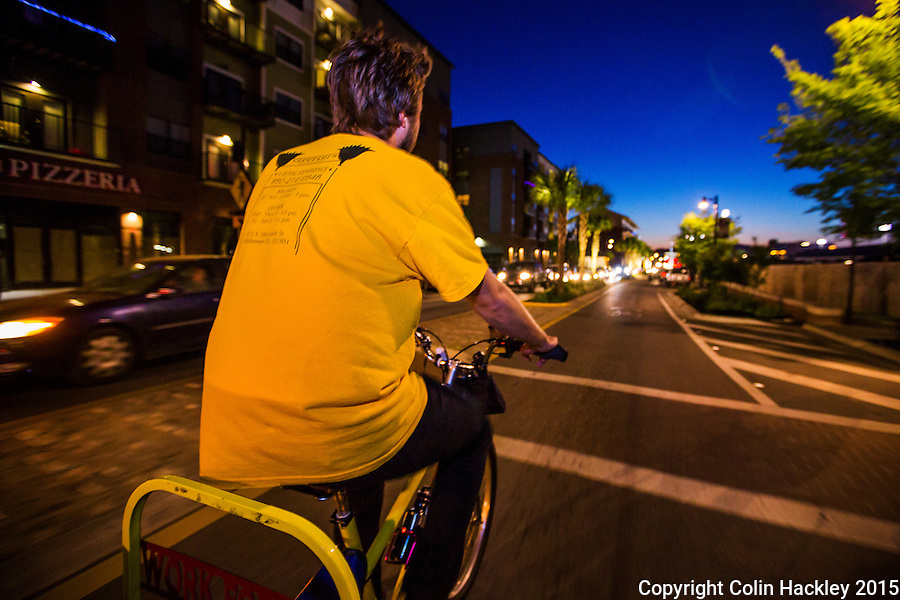 Nick Farrell, a driver with Capital City Pedicabs Gaines gives a smooth ride down Tallahassee's Gaines Street Corridor at dusk. <br /> COLIN HACKLEY PHOTO