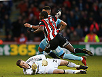 Clayton Donaldson of Sheffield Utd brought down by Robbin Ruiter of Sunderland during the Championship match at Bramall Lane Stadium, Sheffield. Picture date 26th December 2017. Picture credit should read: Simon Bellis/Sportimage