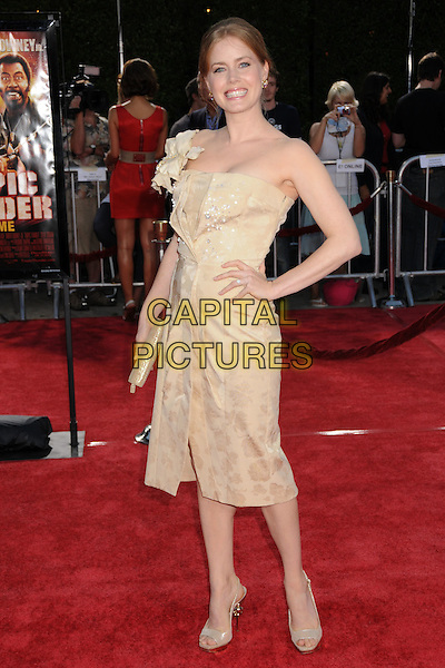 """AMY ADAMS.""""Tropic Thunder"""" Los Angeles Premiere at Mann's Village Theatre, Westwood, California, USA..August 11th, 2008.full length beige dress hand on hip one shoulder .CAP/ADM/BP.©Byron Purvis/AdMedia/Capital Pictures."""
