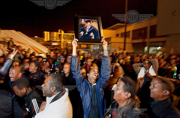 Big crowds of people mourn as the mortal remains of Prime Minister Meles Zenawi arrives at Bole International Airport in Addis Ababa. Prime Minister Meles Zenawi died on August 20. He had been in power since 1991.