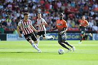 Sheffield United's Lee Evans vies for possession with Swansea City's Joel Asoro during the Sky Bet Championship match between Sheffield United and Swansea City at Bramall Lane, Sheffield, England, UK. Saturday 04 August 2018