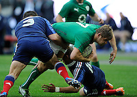 15th March 2014; Chris Henry, Ireland, is tackled by  Nicolas Mas and Gael Fickou of France. RBS Six Nations, France v Ireland, Stade de France, St Denis, Paris. Picture credit: Tommy Grealy/actionshots.ie.