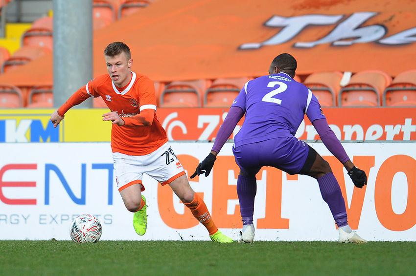 Blackpool's Calum MacDonald under pressure from Maidstone United's Gavin Hoyte<br /> <br /> Photographer Kevin Barnes/CameraSport<br /> <br /> Emirates FA Cup Second Round - Blackpool v Maidstone United - Sunday 1st December 2019 - Bloomfield Road - Blackpool<br />  <br /> World Copyright © 2019 CameraSport. All rights reserved. 43 Linden Ave. Countesthorpe. Leicester. England. LE8 5PG - Tel: +44 (0) 116 277 4147 - admin@camerasport.com - www.camerasport.com