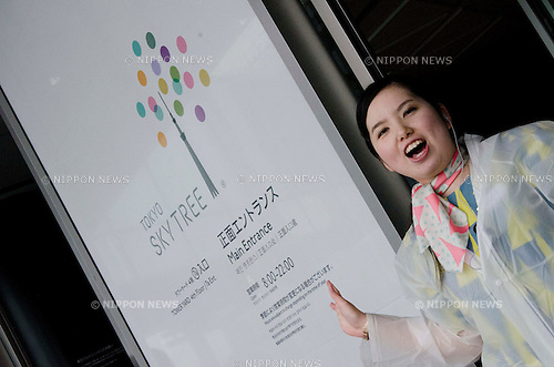 May 22, 2011, Tokyo, Japan - A woman speaks loud to make a line. Tokyo Skytree, the world's tallest self-standing telecommunications tower with a height of 634 meters, opens today. This new Japanese landmark is expected to attract approximately 200,000 visitors on this first official opening day to the general public. (Photo by Yumeto Yamazaki/Nippon News)