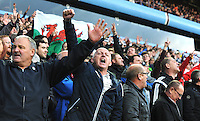 Swansea fans celebrate during the Barclays Premier League match between Aston Villa v Swansea City played at the Villa Park Stadium, Birmingham on October 24th 2015