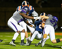 Rogers Heritage quarterback Jeb Brown (2) gets sacked by  Fayetteville's Kaiden Turner (21) at Gates Stadium, Rogers, AR on November 1, 2019 / Special to NWA Democrat Gazette David Beach