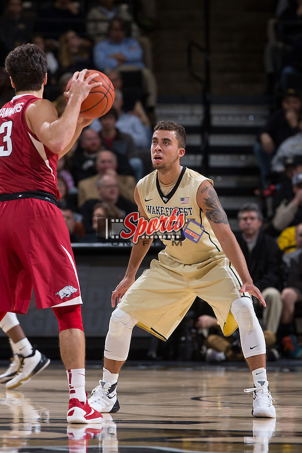 Mitchell Wilbekin (10) of the Wake Forest Demon Deacons guards Dusty Hannahs (3) of the Arkansas Razorbacks during first half action at the LJVM Coliseum on December 4, 2015 in Winston-Salem, North Carolina.  The Demon Deacons defeated the Razorbacks 88-85.  (Brian Westerholt/Sports On Film)