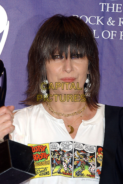 CHRISSIE HYNDE - THE PRETENDERS.2005 Rock and Roll Hall of Fame Induction Ceremony held at the Waldorf Astoria, New York, New York.March 14th, 2005.Photo Credit: Laura Farr/AdMedia.headshot portrait inductee dice earrings jewellery logo slogan comic t-shirt t shirt .www.capitalpictures.com.sales@capitalpictures.com.© Capital Pictures.