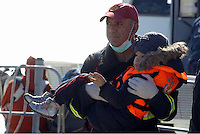 Pictured: A young boy is helped to safety by a member of the emergency services Thursday 27 November 2014<br />