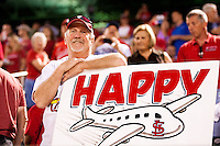 "Marty ""The Sign Man"" stands with one of his famous signs after a game between the St. Louis Cardinals and the Springfield Cardinals at Hammons Field on April 2, 2012 in Springfield, Missouri. (David Welker/Four Seam Images)"