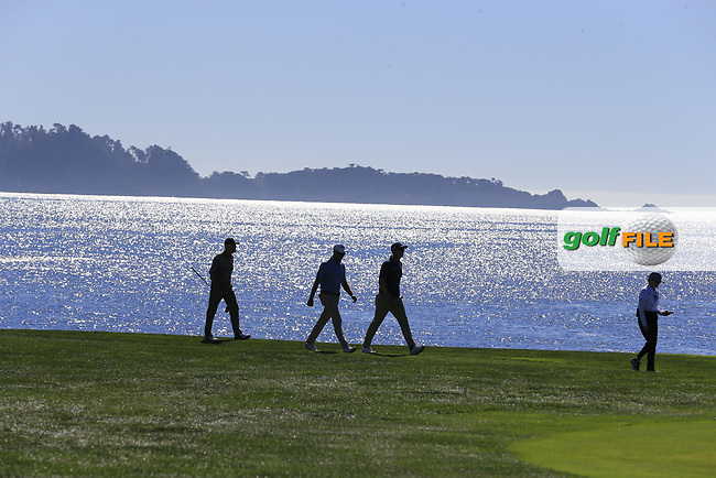 Seamus Power (IRL) and Corey Conners (CAN) on the 18th hole at Pebble Beach course during Friday's Round 2 of the 2018 AT&amp;T Pebble Beach Pro-Am, held over 3 courses Pebble Beach, Spyglass Hill and Monterey, California, USA. 9th February 2018.<br /> Picture: Eoin Clarke | Golffile<br /> <br /> <br /> All photos usage must carry mandatory copyright credit (&copy; Golffile | Eoin Clarke)