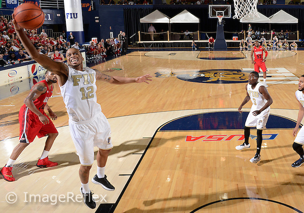 Florida International University guard Dominique Williams (12) plays against Western Kentucky University which won the game 65-58 on January 17, 2015 at Miami, Florida.
