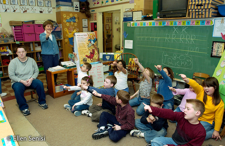 MR / Olean, NY /.Washington West Elementary School, First Grade.Students and teacher sing song with sign language (ASL) to visiting adults from group home. Unique program called Friday Friends pairs adult consumers with special needs with school children. As part of a business-school partnership, consumers and students participate together in reading, crafts, and free time activities. The program's objective is to bring people with and without disabilities together regularly. It is supported by a local, annual fund raising event and hours contributed by volunteers..MR: Oln.© Ellen B. Senisi