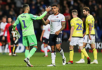 Bolton Wanderers' Josh Magennis shakes hands with Blackburn Rovers' goalkeeper David Raya at the end of the match<br /> <br /> Photographer Andrew Kearns/CameraSport<br /> <br /> The EFL Sky Bet Championship - Bolton Wanderers v Blackburn Rovers - Saturday 6th October 2018 - University of Bolton Stadium - Bolton<br /> <br /> World Copyright &copy; 2018 CameraSport. All rights reserved. 43 Linden Ave. Countesthorpe. Leicester. England. LE8 5PG - Tel: +44 (0) 116 277 4147 - admin@camerasport.com - www.camerasport.com
