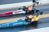 Oct 12, 2019; Concord, NC, USA; NHRA top fuel driver Leah Pritchett (near) races alongside Clay Millican during qualifying for the Carolina Nationals at zMax Dragway. Mandatory Credit: Mark J. Rebilas-USA TODAY Sports
